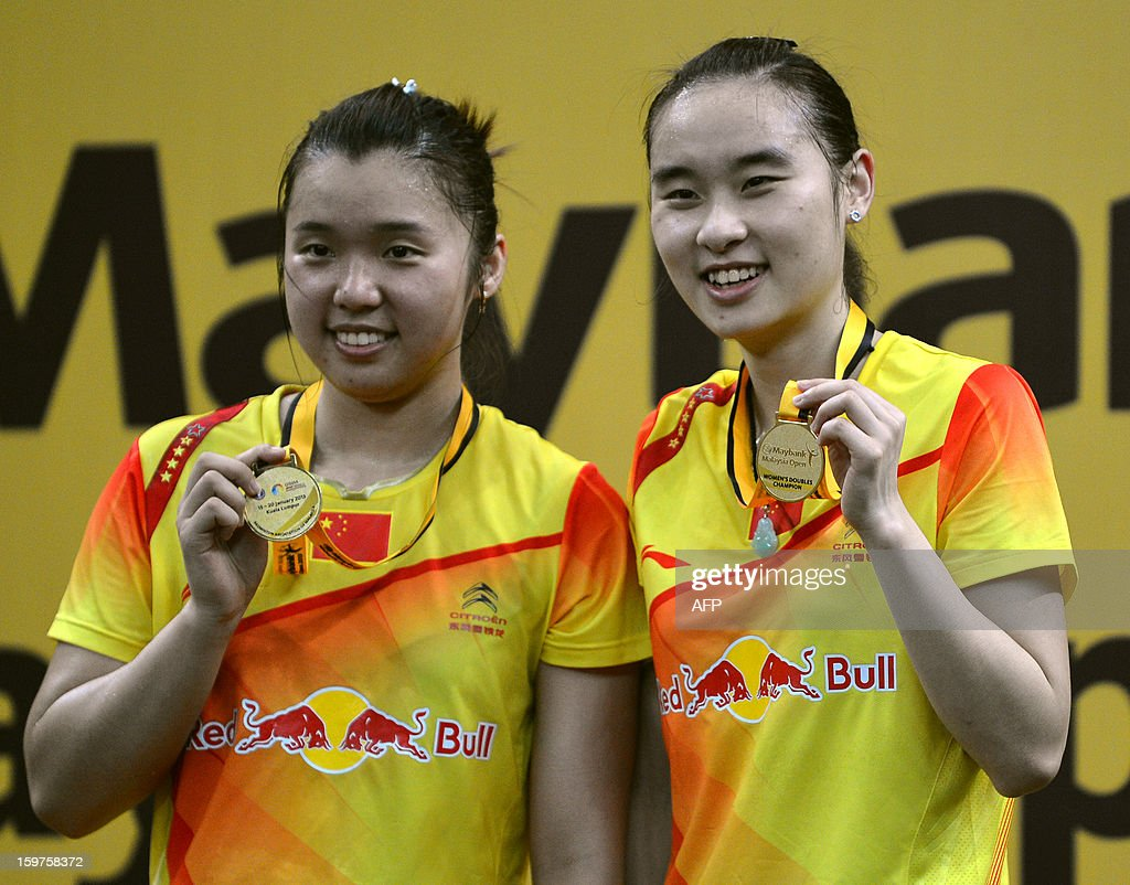 China's Tian Qing (L) and Bao Yixin (R) pose with their gold medals during the awards ceremony after defeating Japan's Misaki Matsutomo and Ayaka Takahashi in the women's doubles final at the Malaysia Open Badminton Superseries in Kuala Lumpur on January 20, 2013.