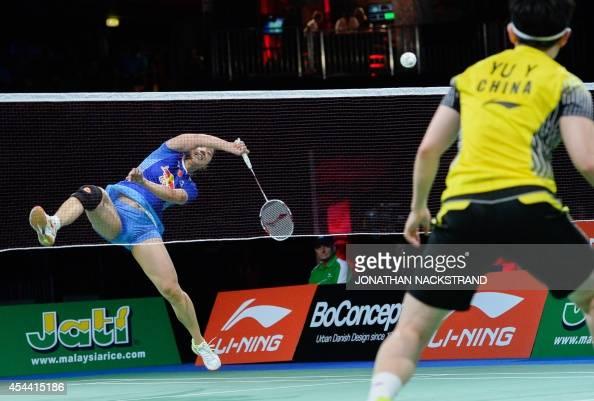 China's Tian Qing and Zhao Yunlei compete against China's Wang Xiaoli and Yu Yang during the women's double final match at the 2014 BWF Badminton...