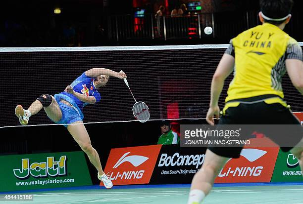 China's Tian Qing and Zhao Yunlei compete against China's Wang Xiaoli and Yu Yang during the women's double final match at the 2014 BWF Badminton...