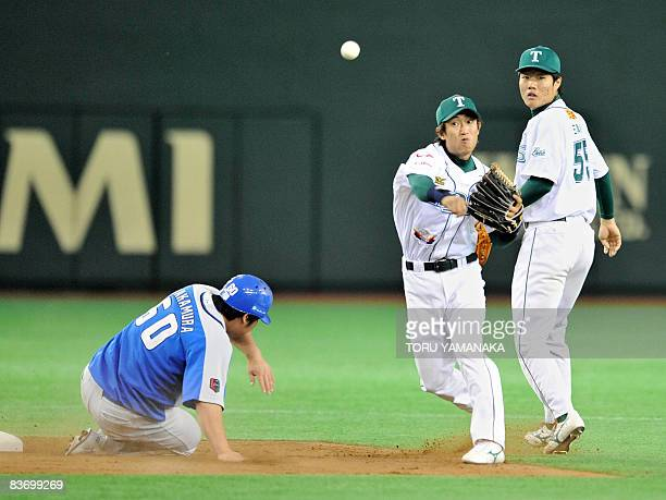 China's Tianjin Lions shortstop Hou Feng Lian throws the ball over infielder Takeya Nakamura of Japan's Saitama Seibu Lions while second baseman Wang...