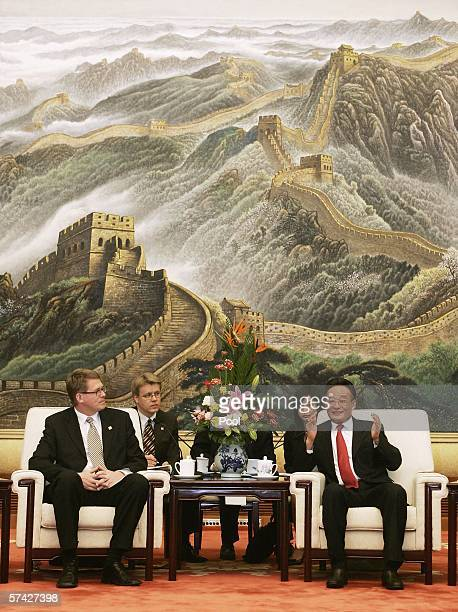 China's top legislator Wu Bangguo welcomes visiting Finnish Prime Minister Matti Vanhanen during a meeting at the Great Hall of the People on April...