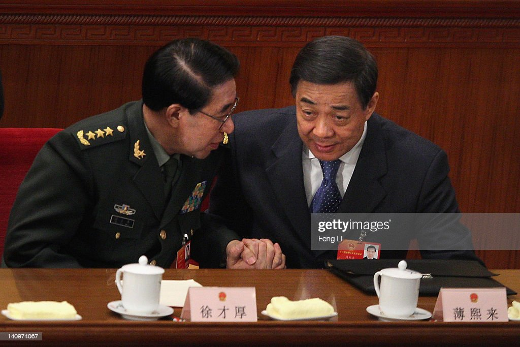 China's vice chairman of the Central Military Commission <a gi-track='captionPersonalityLinkClicked' href=/galleries/search?phrase=Xu+Caihou&family=editorial&specificpeople=4608621 ng-click='$event.stopPropagation()'>Xu Caihou</a> (L) talks shaking hands with Chongqing Municipality Communist Party Secretary <a gi-track='captionPersonalityLinkClicked' href=/galleries/search?phrase=Bo+Xilai&family=editorial&specificpeople=225006 ng-click='$event.stopPropagation()'>Bo Xilai</a> after the third plenary meeting of the National People's Congress (NPC) at The Great Hall Of The People on March 9, 2012 in Beijing, China. China's Chongqing Municipality Communist Party Secretary <a gi-track='captionPersonalityLinkClicked' href=/galleries/search?phrase=Bo+Xilai&family=editorial&specificpeople=225006 ng-click='$event.stopPropagation()'>Bo Xilai</a> said he was surprised to learn that his ex-police chief had run off to a US consulate during the the National People's Congress Chongqing group meeting today.