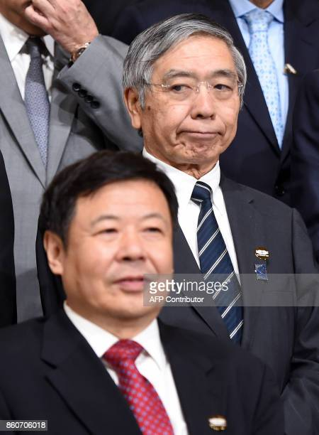 China's Vice Finance Minister Zhu Guagyao looks on near Haruhiko Kuroda Governor of the Bank of Japan before the G20 Finance ministers group photo at...