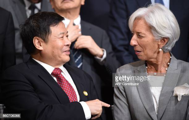 China's Vice Finance Minister Zhu Guagyao speaks with IMF Managing Director Christine Lagarde before the G20 Finance ministers group photo at the IMF...