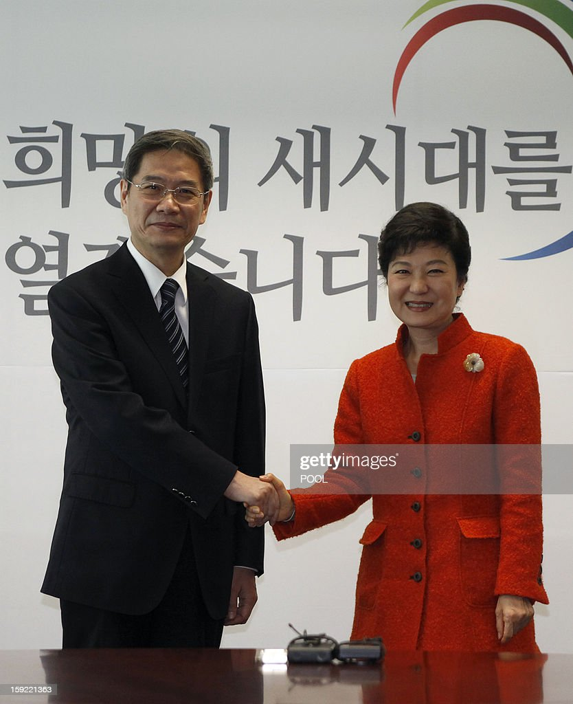 China's Vice Foreign Minister Zhang Zhijun (L) shakes hands with South Korea's president-elect Park Geun-Hye during their meeting at Park's office in Seoul January 10, 2012. The meeting took place as part of discussions on the development of bilateral ties between South Korea and China. AFP PHOTO / POOL / Kim Hong-Ji