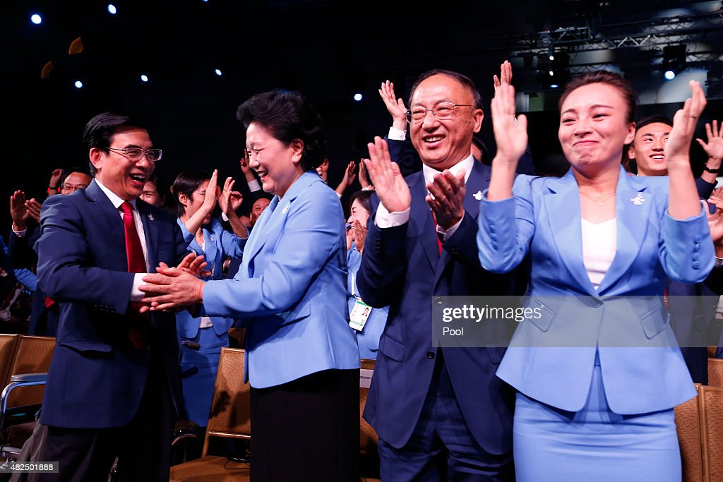 China's Vice Premier <a gi-track='captionPersonalityLinkClicked' href=/galleries/search?phrase=Liu+Yandong&family=editorial&specificpeople=4375362 ng-click='$event.stopPropagation()'>Liu Yandong</a> (2nd,R), Mayor of Beijing Wang Anshun, President of the Chinese Olympic Committee Liu Peng and members of the of the Beijing 2022 Olympic Winter Games Bid Committee celebrate after Beijing, China was announced as the host city for the 2022 Winter Olympics during the Announcement Ceremony at the 128th IOC Session at the Kuala Lumpur Convention Centre on July 31, 2015 in Kuala Lumpur, Malaysia.