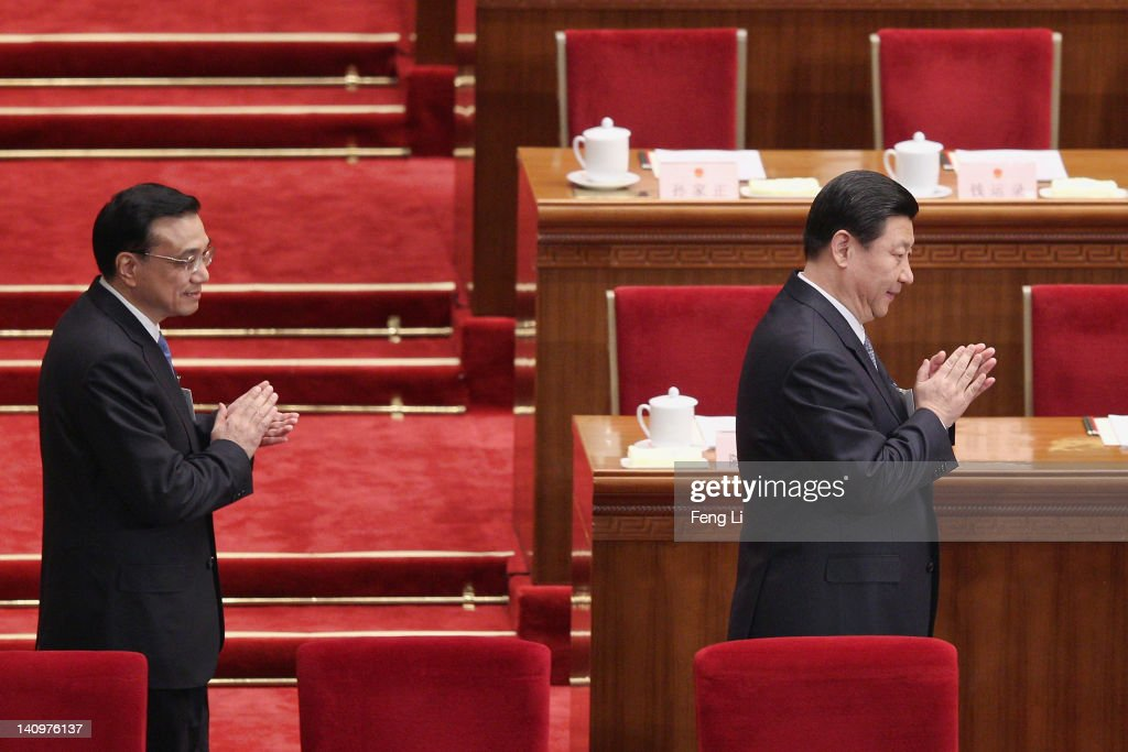 China's Vice President <a gi-track='captionPersonalityLinkClicked' href=/galleries/search?phrase=Xi+Jinping&family=editorial&specificpeople=2598986 ng-click='$event.stopPropagation()'>Xi Jinping</a> (R) and Vice Premier <a gi-track='captionPersonalityLinkClicked' href=/galleries/search?phrase=Li+Keqiang&family=editorial&specificpeople=2481781 ng-click='$event.stopPropagation()'>Li Keqiang</a> (L) walk as he arrives for the third plenary meeting of the National People's Congress (NPC) at The Great Hall Of The People on March 9, 2012 in Beijing, China. Known as 'liang hui,' or 'two organizations', it consists of meetings of China's legislature, the National People's Congress (NPC), and its advisory auxiliary, the Chinese People's Political Consultative Conference (CPPCC).