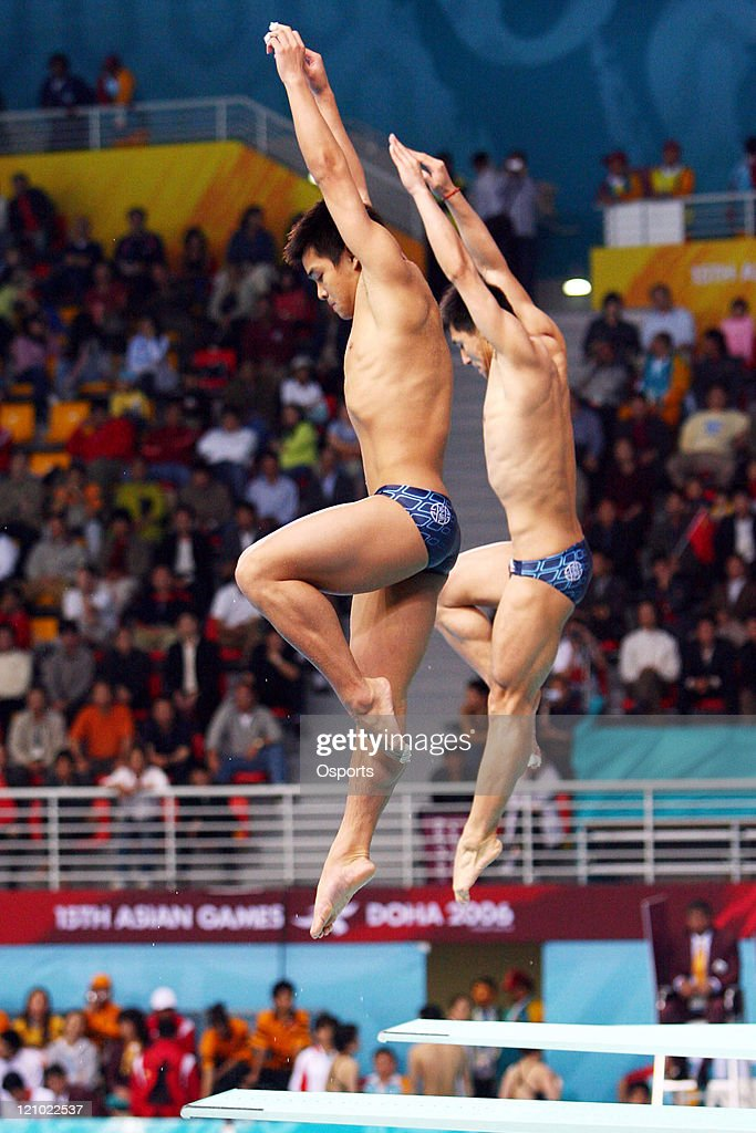 China's Wang Feng and He Chong perform their dive during the Asian Games Diving Men's Synchronized 3m Springboard final in the 15th Asian Games Doha...