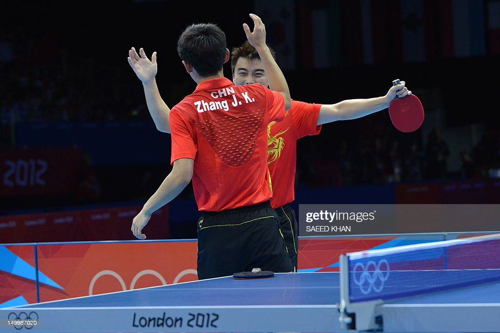 China's Wang Hao (R) and China's Zhang Jike celebrate scoring the winning point to win gold against South Korea's Oh Sangeun and South Korea's Ryu Seungmin during the table tennis men's team final China vs South Korea at the London Olympic games on August 8, 2012 at the Excel arena in London. AFP PHOTO / SAEED KHAN