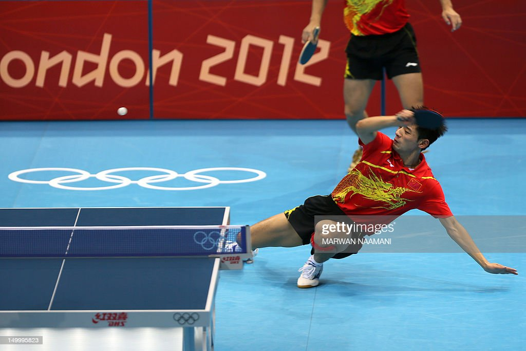 China's Wang Hao and Zhang Jike (R) returns a ball to South Korea's Oh Sangeun and South Korea's Ryu Seungmin during the table tennis men's team final China vs South Korea at the London Olympic games on August 8, 2012 at the Excel arena in London.