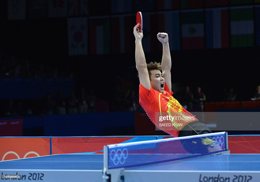China's Wang Hao celebrates scoring the winning point with China's Zhang Jike to win gold against South Korea's Oh Sangeun and South Korea's Ryu Seungmin during the table tennis men's team final China vs South Korea at the London Olympic games on August 8, 2012 at the Excel arena in London.