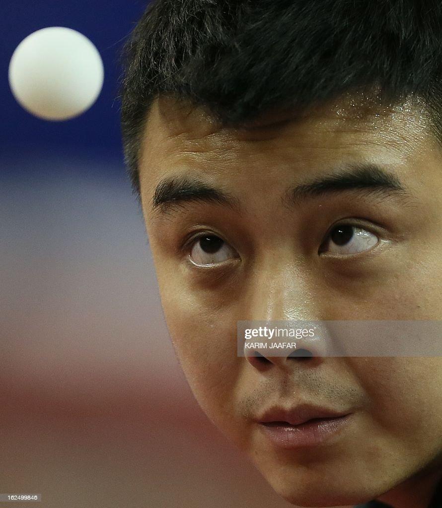 China's Wang Hao eyes the ball as he hits a return to China's Yan An during the men's singles semi-final table tennis match of the ITTF Pro Tour Qatar Open on February 24, 2013 in the Qatari capital, Doha. AFP PHOTO / AL-WATAN DOHA / KARIM JAAFAR == QATAR OUT ==