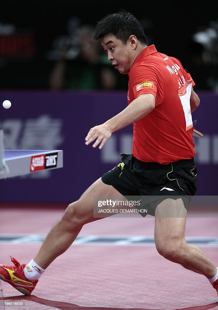 China's Wang Hao returns a ball to China's Zhang Jike during the Men's Singles final of the World Table Tennis Championships on May 20, 2013 in Paris. Zhang Jike won the final.
