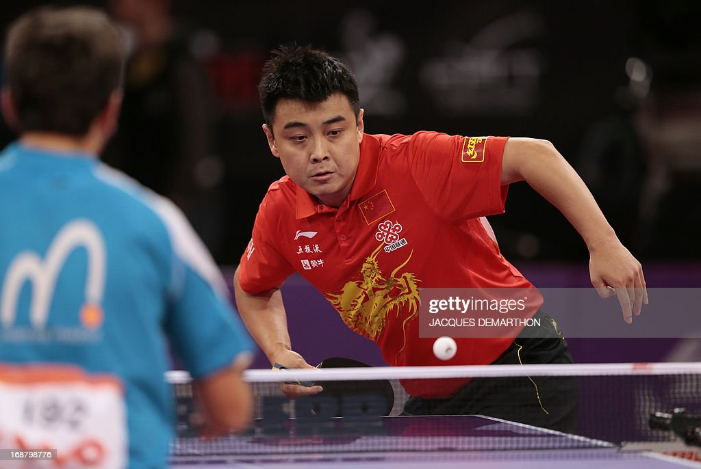 China's Wang Hao returns a ball to Mexico's Marcos Madrid on May 15, 2013 in Paris during the first round of the Men's Singles of the World Table Tennis Championships. DEMARTHON