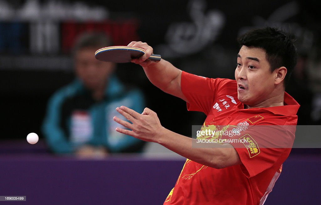 China's Wang Hao returns a ball to Singapore's Gao Ning on May 18, 2013 in Paris during the round of sixteen of the Men's Singles category of the World Table Tennis Championships. AFP PHOTO / JACQUES DEMARTHON