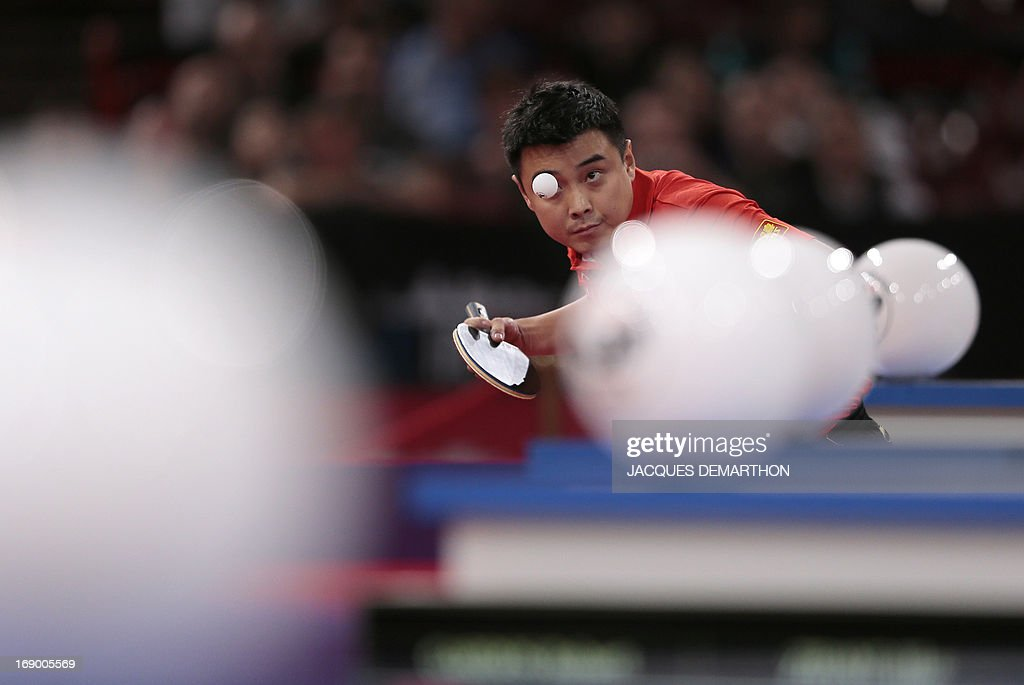 China's Wang Hao returns a ball to Singapore's Gao Ning on May 18, 2013 in Paris during the round of sixteen of the Men's Singles category of the World Table Tennis Championships.