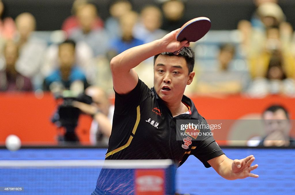 China's Wang Hao returns a shot against Serbia's Bojan Crepulja during their match in the men's team championship division group A at the 2014 World Team Table Tennis Championships in Tokyo on May 1, 2014.