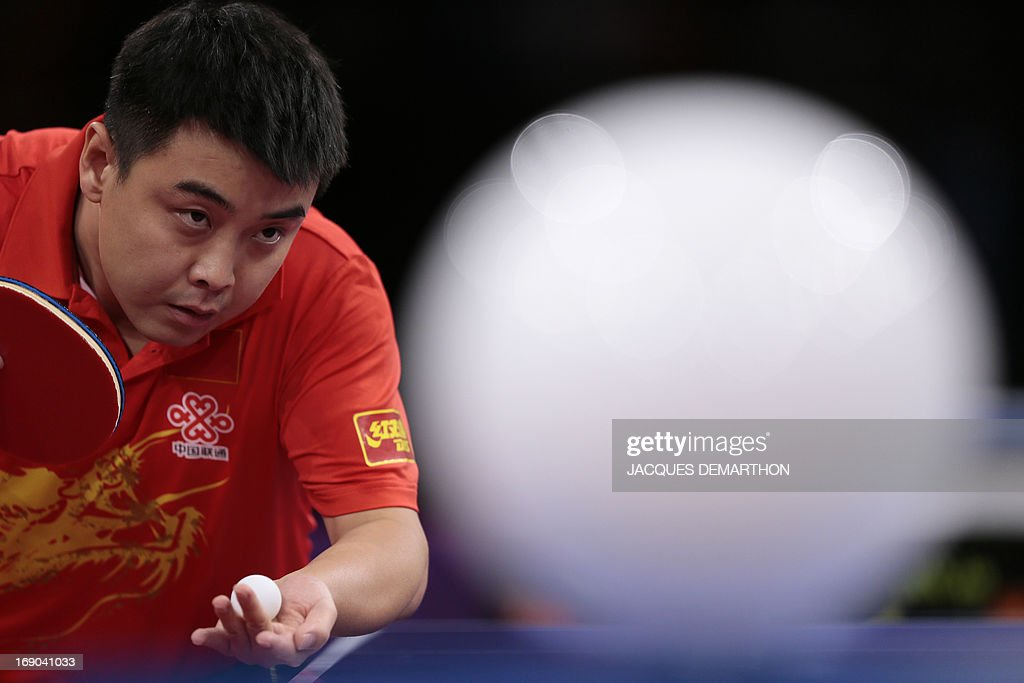 China's Wang Hao (L) serves to China's Yan An (R) on May 19, 2013 in Paris during their Men's quarter-final match of the World Table Tennis Championships.