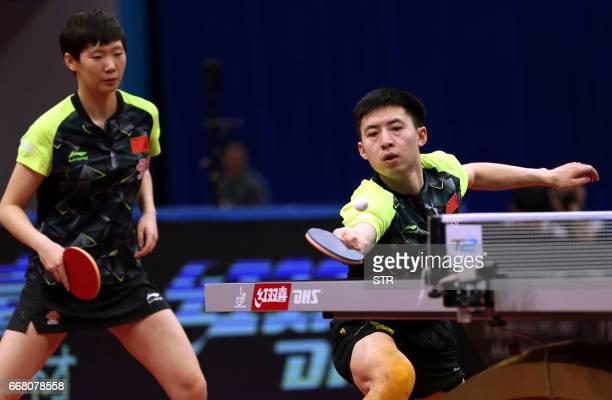 China's Wang Manyu and Fang Bo play during their mixed doubles semifinal against Japan's Masataka Morizono and Mima Ito at the Asian Table Tennis...