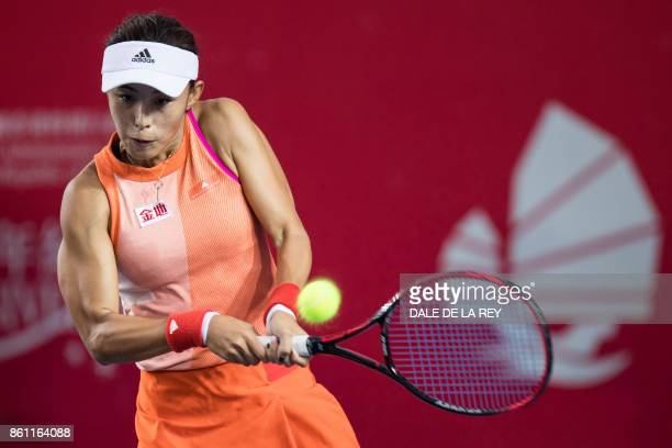 China's Wang Qiang hits a return against Russia's Anastasia Pavlyuchenkova during their women's singles semifinal match at the Hong Kong Open tennis...