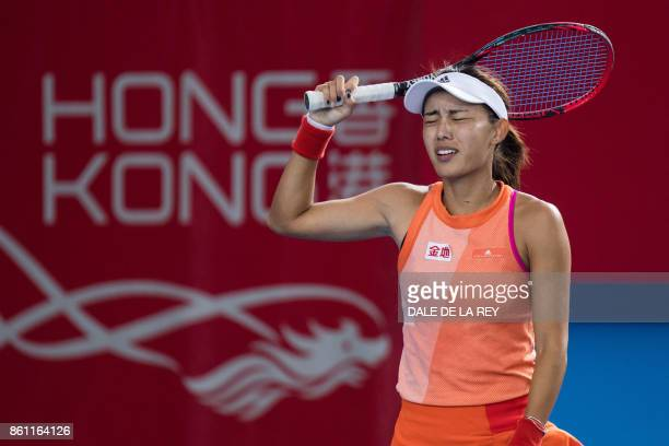 China's Wang Qiang reacts after losing a point against Russia's Anastasia Pavlyuchenkova during their women's singles semifinal match at the Hong...