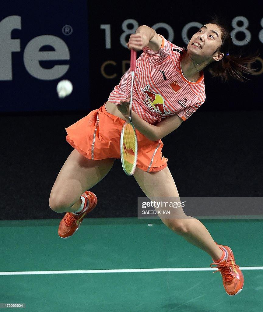 China s Wang Shixian plays a shot against India s Saina Nehwal
