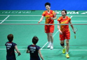 China's Wang Xiaoli and Yu Yang celebrate winning over Japan's Satoko Suetsun and Miyuki Maeda during the All England Open Badminton Championships...