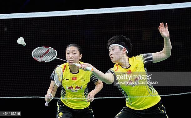 China's Wang Xiaoli and Yu Yang compete against China's Tian Qing and Zhao Yunlei during the women's double final match at the 2014 BWF Badminton...