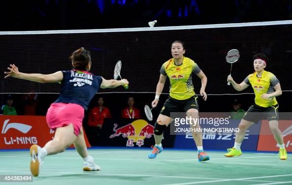 China's Wang Xiaoli and Yu Yang compete against Japan's Reika Kakiiwa and Miyuki Maeda during the women's double semi final match at the 2014 BWF...