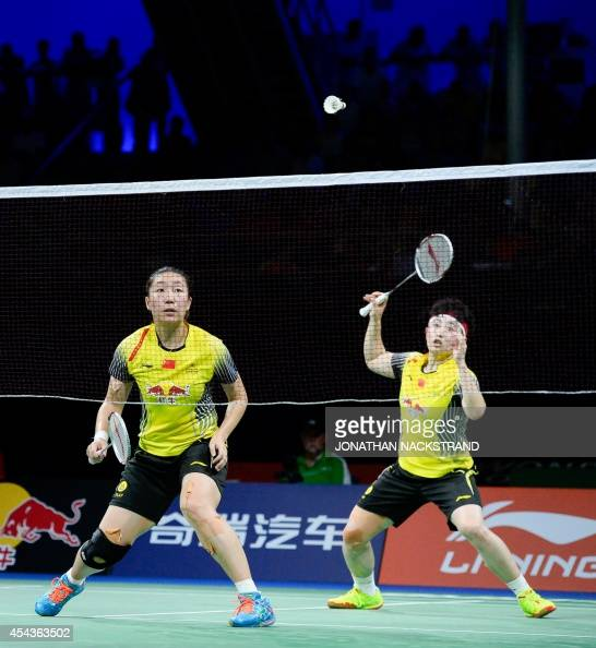 China's Wang Xiaoli and Yu Yang compete against Japan's team during the women's double semi final match at the 2014 BWF Badminton World championships...