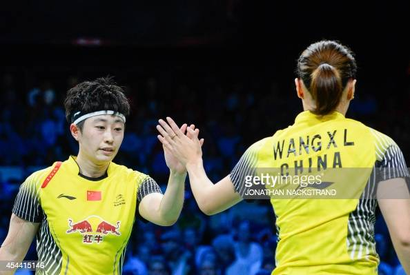 China's Wang Xiaoli and Yu Yang react as they compete against China's Tian Qing and Zhao Yunlei during the women's double final match at the 2014 BWF...