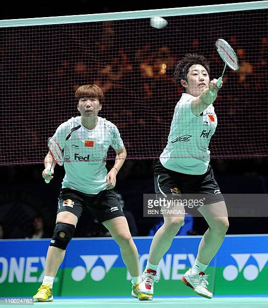 China's Wang Xiaoli and Yu Yang return a shot to Denmark's Line Damkjaer and Marie Roepke during the womens doubles semi final of the Badminton All...