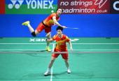 China's Wang Xiaoli and Yu Yang return to Japan's Satoko Suetsun and Miyuki Maeda during the All England Open Badminton Championships women's doubles...