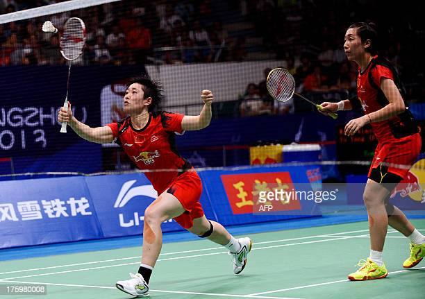 China's Wang Xiaoli and Yu Yang return to South Korea's Eom Hye Won and Jang Ye Na during their women's doubles final at World Badminton...