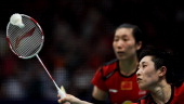 China's Wang Xiaoli and Yu Yang return to South Korea's Eom Hye Won and Jang Ye Na during their women's doubles final at World Badminton...