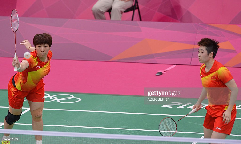 China's Wang Xiaoli (L) plays a shot as Yu Yang looks on during their women's double badminton match against Valeria Sorokina and Nina Vislova of Russia at the London 2012 Olympic Games in London on July 29, 2012. Wang/Yu won the match 21-6, 21-9.
