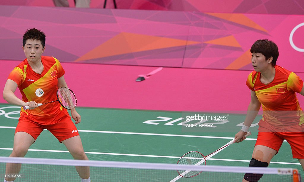 China's Wang Xiaoli (R) plays a shot as Yu Yang looks on during their women's double badminton match against Valeria Sorokina and Nina Vislova of Russia at the London 2012 Olympic Games in London on July 29, 2012. Wang/Yu won the match 21-6, 21-9.