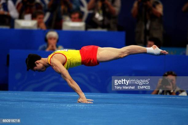 China's Wei Yang performs his floor routine in the men's team event