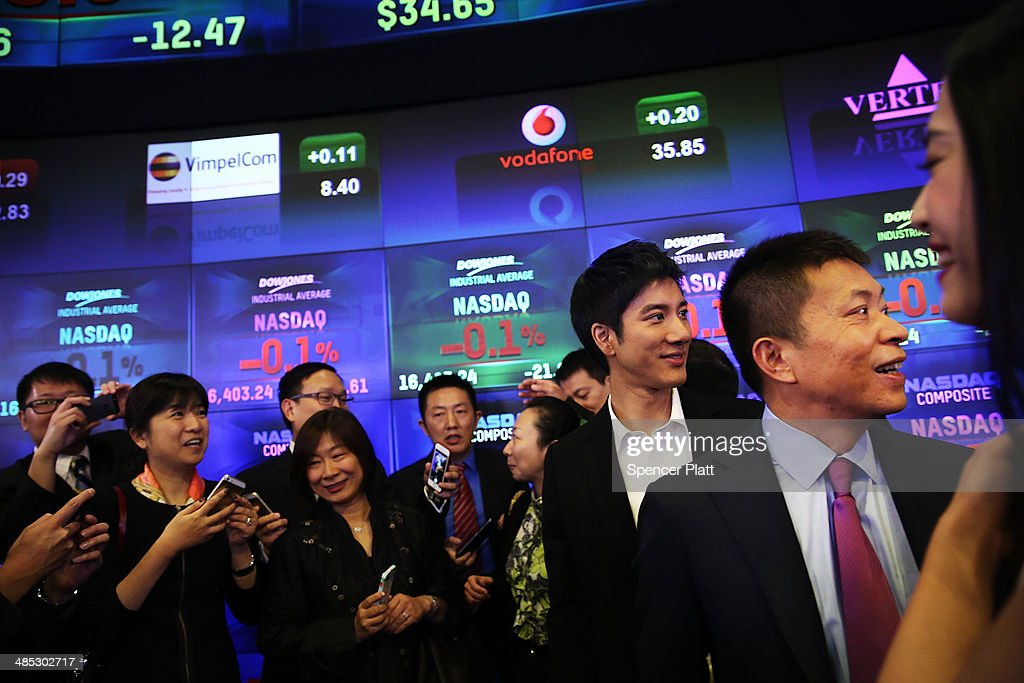 China's Weibo CEO Charles Chao (right) pauses moments after Weibo began trading on the Nasdaq exchange under the ticker symbol WB on April 17, 2014 in New York City. Weibo Corp, a Twitter-like messaging service company, priced its initial public offering (IPO) at $17 per American Depository Share (ADS).