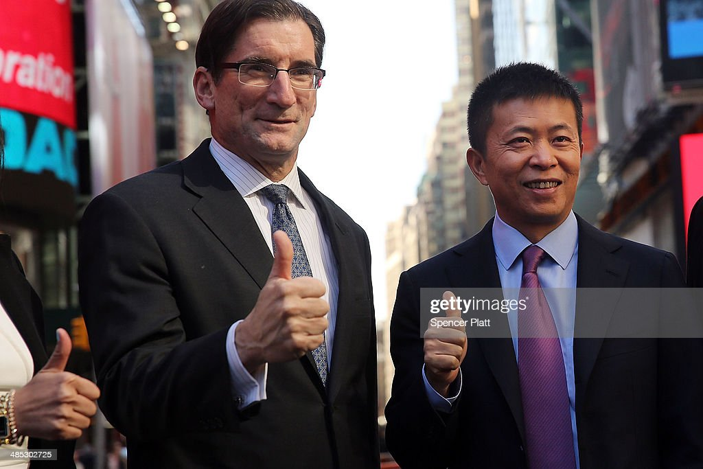 China's Weibo CEO Charles Chao (right) stands with Robert Greifeld, Nasdaq CEO, moments after Weibo began trading on the Nasdaq exchange under the ticker symbol WB on April 17, 2014 in New York City. Weibo Corp, a Twitter-like messaging service company, priced its initial public offering (IPO) at $17 per American Depository Share (ADS).