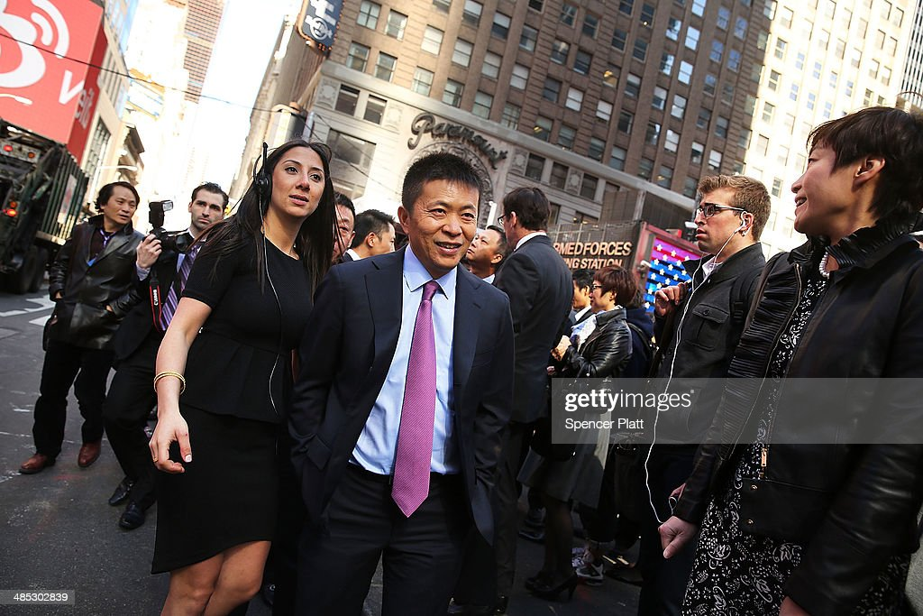 China's Weibo CEO Charles Chao walks in Times Square moments after Weibo began trading on the Nasdaq exchange under the ticker symbol WB on April 17, 2014 in New York City. Weibo Corp, a Twitter-like messaging service company, priced its initial public offering (IPO) at $17 per American Depository Share (ADS).