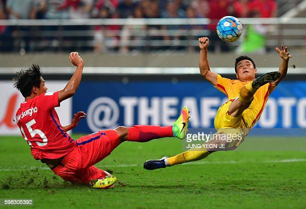 China's Wu Lei fights for the ball with South Korea's Hong JeongHo during their 2018 World Cup qualifying football match in Seoul on September 1 2016...