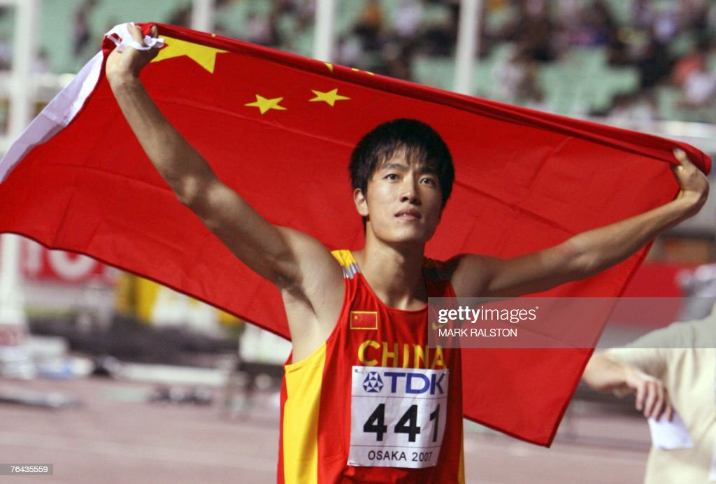 China's Xiang Liu celebrates after the men's 110m hurdles final, 31 August 2007, at the 11th IAAF World Athletics Championships, in Osaka. China's Xiang Liu won ahead of USA's Terrence Trammell and USA's David Payne. AFP PHOTO / MARK RALSTON