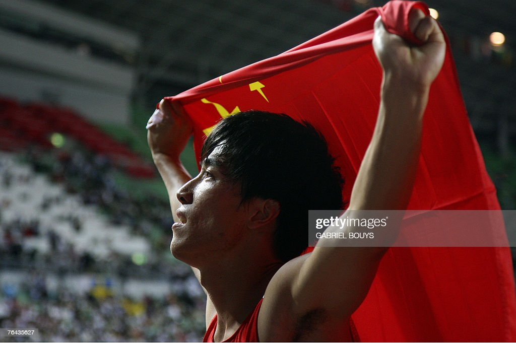 China's Xiang Liu celebrates after the men's 110m hurdles final, 31 August 2007, at the 11th IAAF World Athletics Championships, in Osaka. China's Xiang Liu won ahead of USA's Terrence Trammell and USA's David Payne. AFP PHOTO / GABRIEL BOUYS