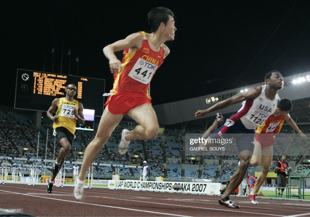 China's Xiang Liu crosses the line infront of USA's David Payne (C) during the men's 110m hurdles final, 31 August 2007, at the 11th IAAF World Athletics Championships, in Osaka. China's Xiang Liu won ahead of USA's Terrence Trammell and USA's David Payne. AFP PHOTO / GABRIEL BOUYS