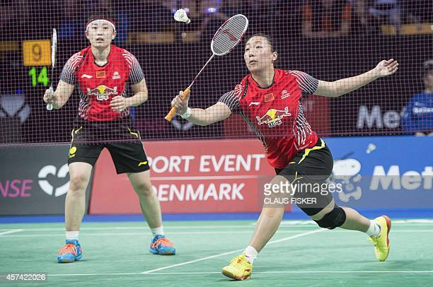 Chinas Xiaoli Wang and Yu Yang return against China's Jin Ma and Yuanting Tang during the women's double semifinal match of the Denmark Open 2014...