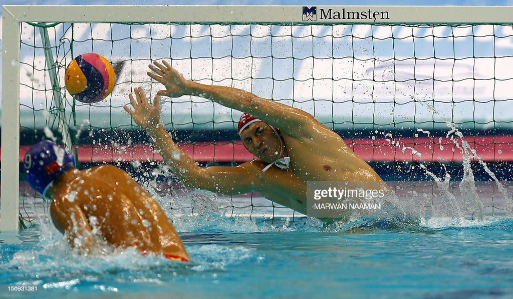 China's Xie Junmin scores the winning goal against Kazakhstan in a penalty shoot out to win the gold medal in the final of the men's water polo championship at the 9th Asian Swimming Championships in Dubai, on November 25, 2012. China won 4-2 in a penalty shoot-out after a 9-9 draw at the final whistle. AFP PHOTO/MARWAN NAAMANI
