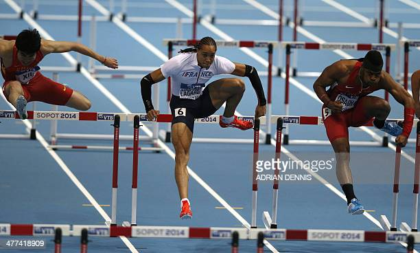 China's Xie Wenjun France's Pascal MartinotLagarde US Omo Osaghae compete in the men 60 m Hurdles SemiFinal event at the IAAF World Indoor Athletics...