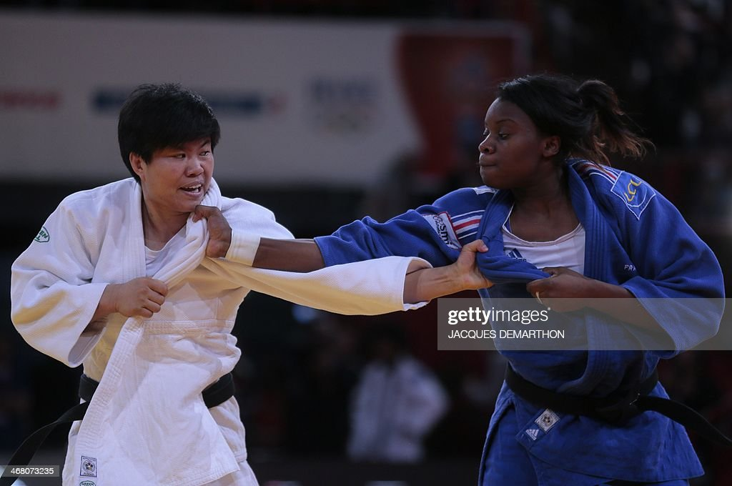 China's Xin Li grapples with France's Madeleine Malonga during the women's 78kg semifinals at the 2014 Paris Judo Grand Slam tournament on February 9...