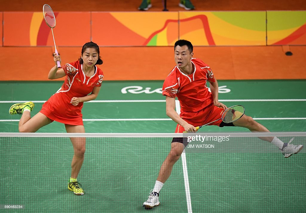 China's Xu Chen and China's Ma Jin react as they return against China's Zhang Nan and China's Zhao Yunlei during their mixed doubles Bronze Medal...